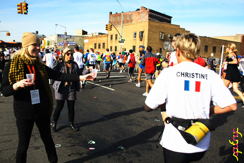 photo ~ giving water out in between performances ~ 2008-11-02 ~ Manyc Records at New York City Marathon 2008 ~ sputnyc