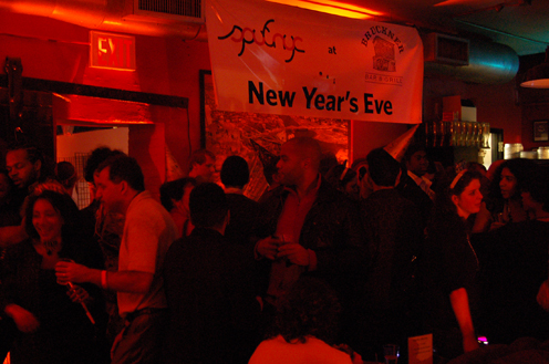 photo ~ sputnyc banner, revelers ~ Arnaud Stebe ~ 2010-01-01 ~ New Year's Eve 2010 Celebration 10th Anniversary Event ~ sputnyc