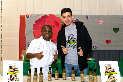 photo ~ at reception with samples of The Bronx Greenmarket Hot Sauce ~ Heriberto Sanchez ~ 2015-02-27 ~ Spring Bank presents Healthy Hearts ~ sputnyc